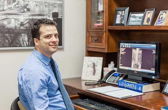 Chiropractor Escondido CA Dr. Scott Karges At Desk